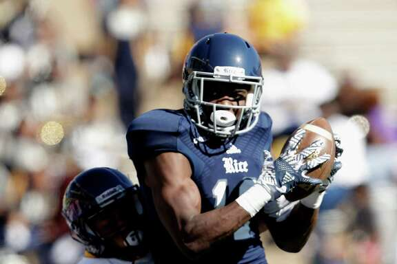 Rice Owls wide receiver Temi Alaka (12) catches a pass for a touchdown defended by Prairie View A&M Panthers cornerback Sonnie Williams (30) in the second quarter during the NCAA football game between the Prairie View A&M Panthers and the Rice Owls at Rice Stadium in Houston, TX on Saturday, October 22, 2016.   The Owls lead the Panthers 45-14 at halftime.