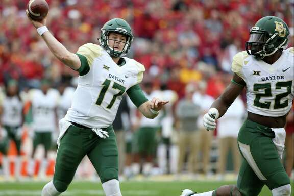Baylor quarterback Seth Russell throws a touchdown pass during the second half of an NCAA college football game against Iowa State, Saturday, Oct. 1, 2016, in Ames, Iowa. Baylor won 45-42. (AP Photo/Justin Hayworth)