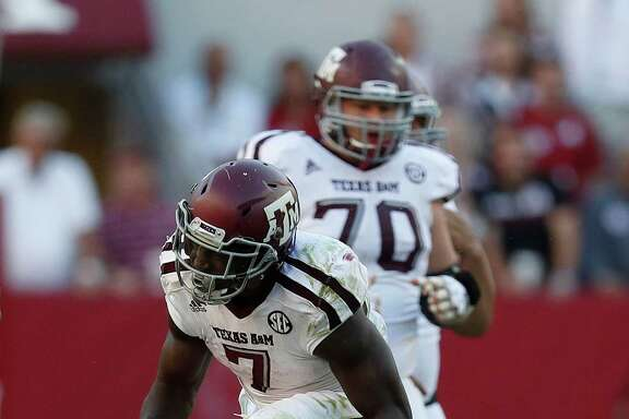 Texas A&M Aggies running back Keith Ford (7) reacts after a run during the third quarter of a college football game at Bryant-Denny Stadium, Saturday,Oct. 22, 2016 in Tuscaloosa.   ( Karen Warren / Houston Chronicle )