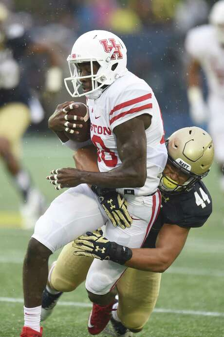 ANNAPOLIS, MD - OCTOBER 08:  Micah Thomas #44 of the Navy Midshipmen tries to tackle Steven Dunbar #88 of the Houston Cougars while running with the ball in first period during a football game at Navy-Marines Memorial Stadium on October 8, 2016 in Annapolis, Maryland.  (Photo by Mitchell Layton/Getty Images) Photo: Mitchell Layton, Stringer / 2016 Getty Images