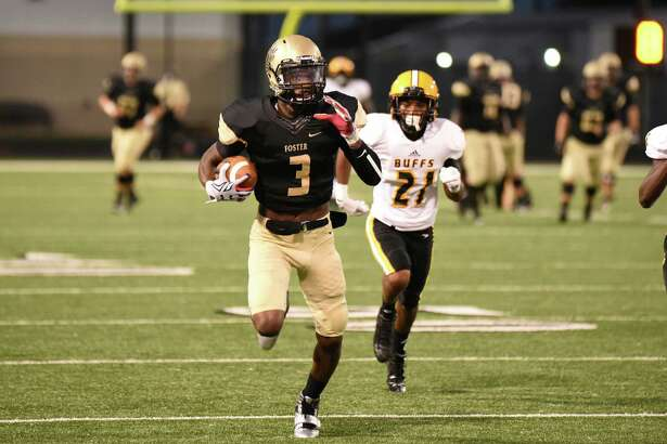 Foster Falcons wide receiver Cedarian Lamb (3) runs for a touchdown after making a catch against the Fort Bend Marshall Buffalos during the first quarter of a high school football game on Friday, Sept. 18, 2015, at Traylor Stadium in Rosenberg. ( Andrew Richardson / Houston Chronicle )