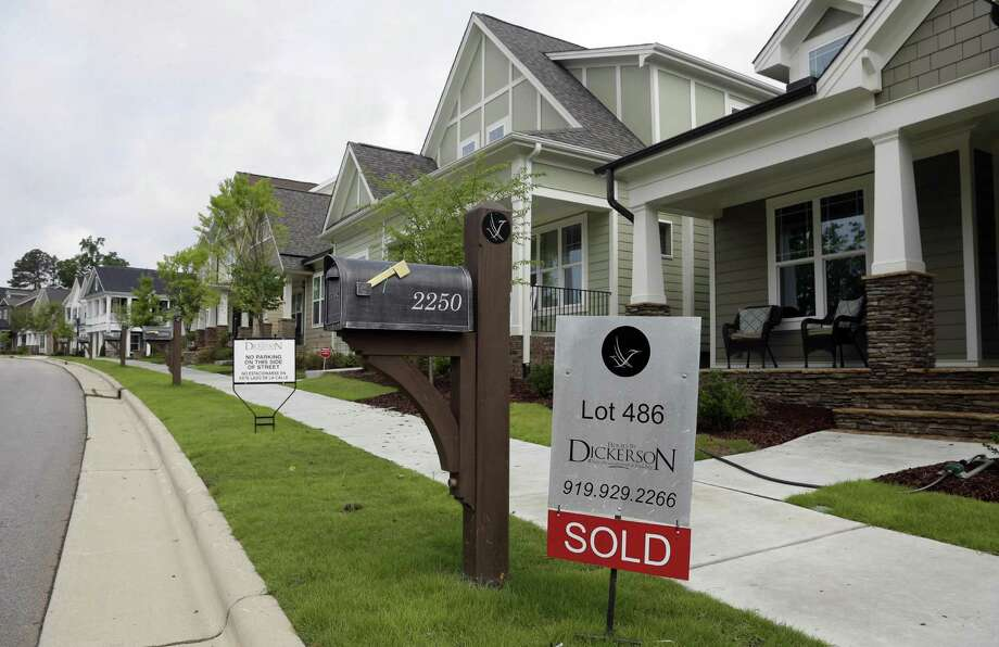 Freddie Mac said the average for a 30-year fixed-rate mortgage eased to 3.47 percent, close to its all-time low of 3.31 percent in November 2012. Photo: Associated Press /File Photo / Copyright 2016 The Associated Press. All rights reserved.