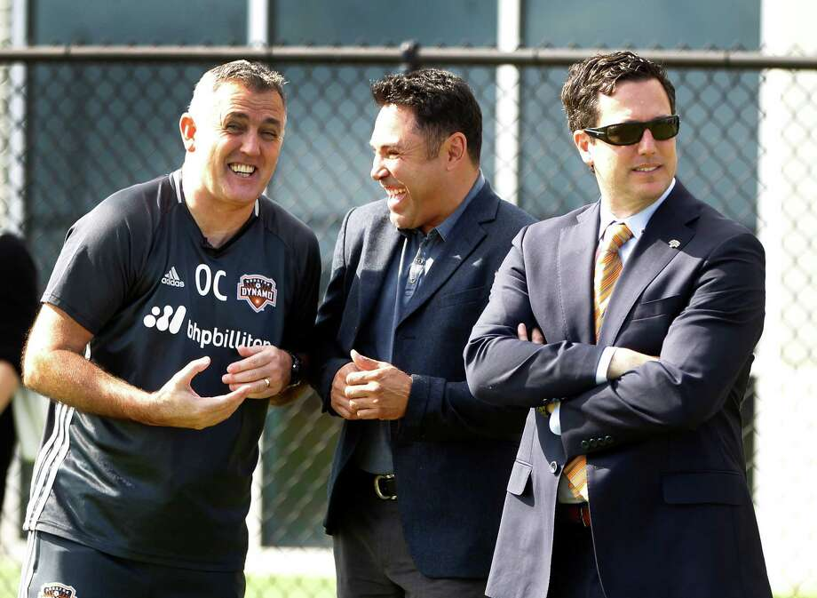 There was little to laugh about during the 2016 season for Dynamo president Chris Canetti, right. The trying campaign including parting ways with coach Owen Coyle, far left, early in the season. Photo: Karen Warren, Staff / © 2015  Houston Chronicle
