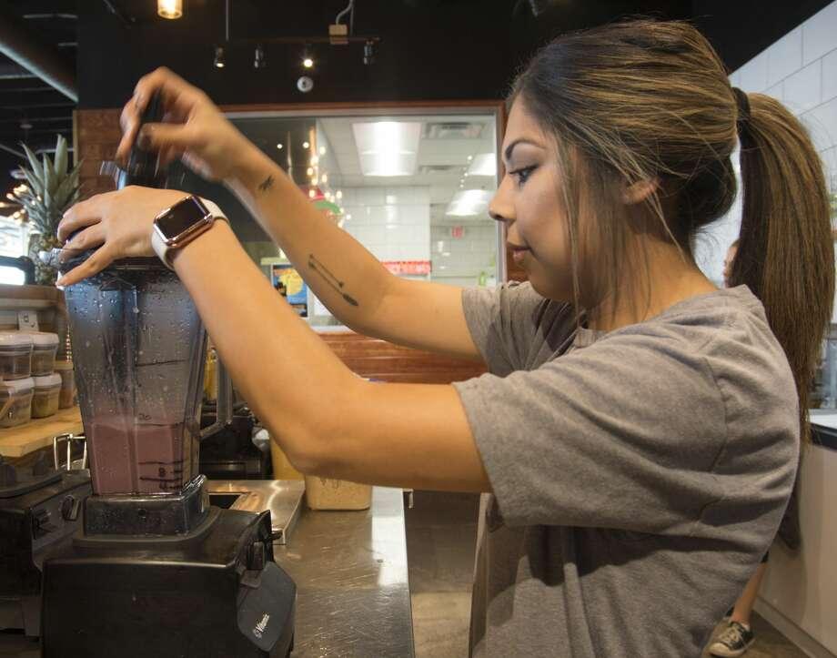 Julia Ortiz blendstogether freshingredients for anAB&J bowl at Living360 on Oct. 27. Photo: Tim Fischer/Midland Reporter-Telegram