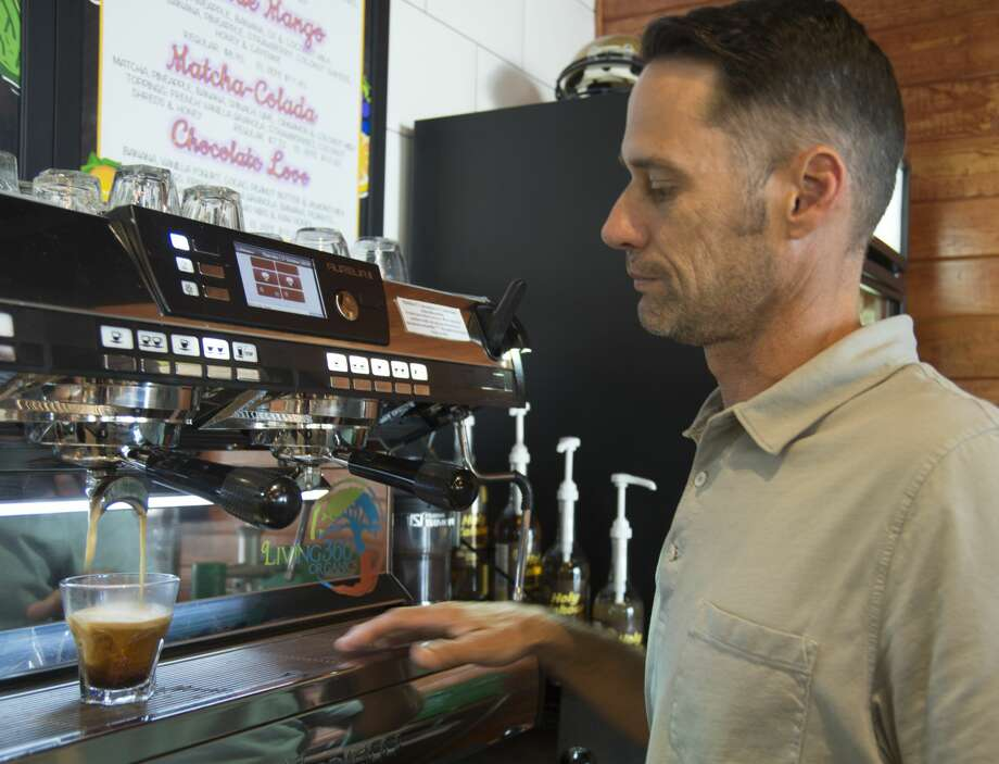 Living 360owner KellyBrown pullsa shot oforganic beanespresso. Photo: Tim Fischer/Midland Reporter-Telegram