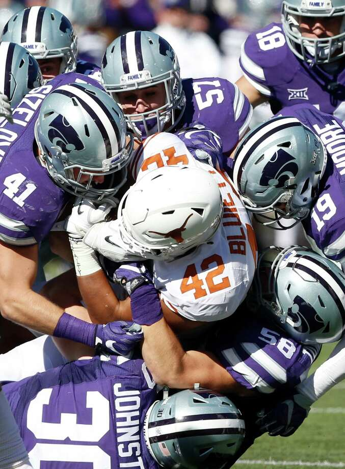 Texas tight end Caleb Bluiett (42) is stopped by Kansas State defenders in the second quarter at Snyder Family Stadium in Manhattan, Kan., on Saturday, Oct. 22, 2016. Kansas State won, 24-21. (Bo Rader/Wichita Eagle/TNS) Photo: Bo Rader, MBR / Wichita Eagle