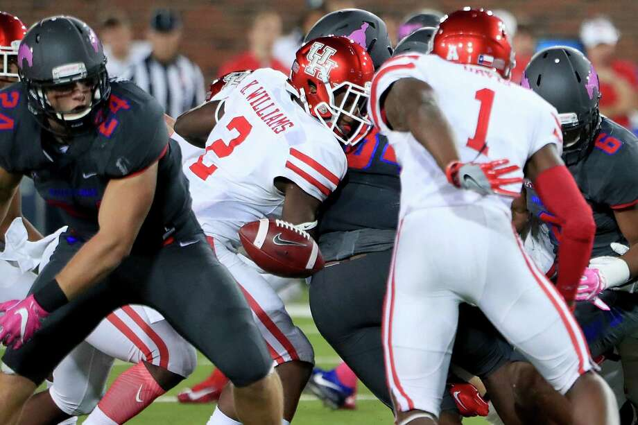 DALLAS, TX - OCTOBER 22:  Duke Catalon #2 of the Houston Cougars fumbles the ball against Mitchell Kaufman #24 of the Southern Methodist Mustangs in the second half at Gerald J. Ford Stadium on October 22, 2016 in Dallas, Texas.  (Photo by Tom Pennington/Getty Images) Photo: Tom Pennington, Staff / 2016 Getty Images