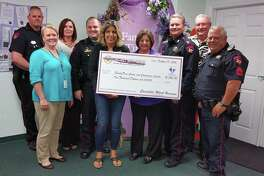 Harris County Precinct 4 Constable Mark Herman's office presented FamilyTime Crisis and Counseling Center's Executive Director Judy Cox and the nonprofit a $1,000 check donation. This donation will help FamilyTime continue to provide an outreach program and accessible services, information and shelter to victims of domestic abuse.