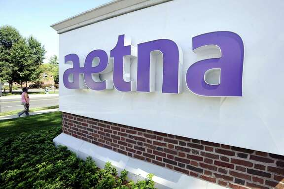 Aetna's enrollment in government programs such as Medicaid and Medicare grew 11 percent, to nearly 4.5 million people, and the insurer said Thursday that segment now contributes about half of its total health care premiums.