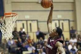 St. Anthony big man Charles Bassey throws down a slam as the Yellow Jackets play Central Catholic in boys basketball at Greehey Arena on January 21, 2016. (Staff photo)