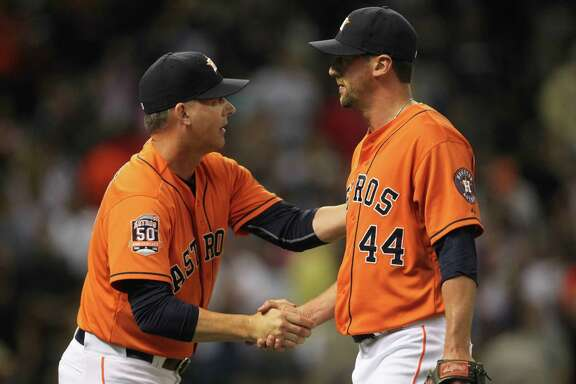 Astros manager A.J. Hinch, left, tabbed three different relievers, including Luke Gregerson, with the closer job at various times during the 2016 season.