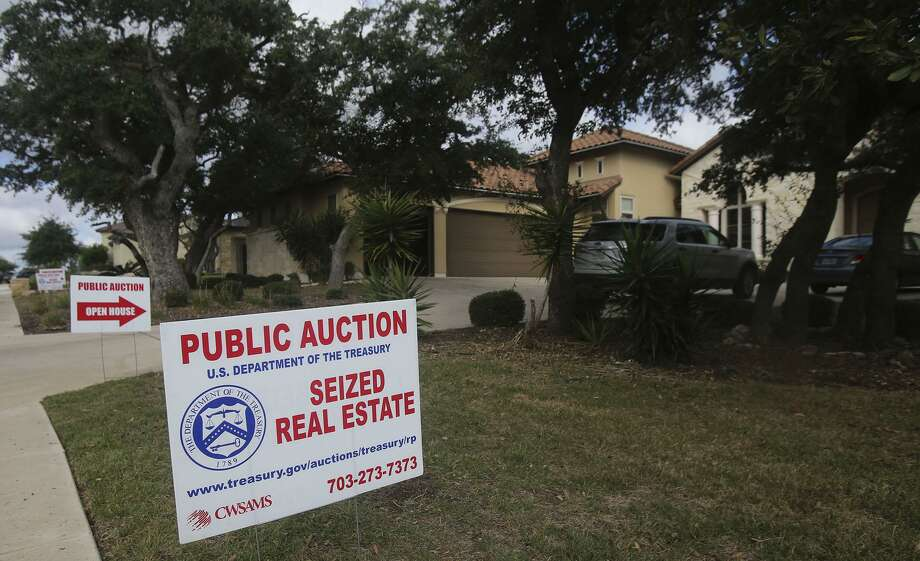 This Mediterranean style home located in Cibolo Canyons on San Antonio's North Side was auctioned off by the U.S. Government for $690,000 to winning bidder Karim Charania. The home was seized from former Coahuila, Mexico treasurer Hector Javier Villarreal. A lot next door was also sold for $100,000 to a different bidder who would not release their identity. Photo: John Davenport, Staff / San Antonio Express-News / ©San Antonio Express-News/John Davenport