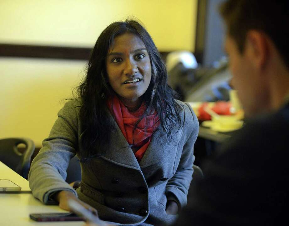 Ashwini Anburan, CEO and Founder of OpenUp, talks about her experience following her UberPitch ride aroound Stamford, Conn. on Wednesday, Oct. 26, 2016 with a local investor. Photo: Matthew Brown / Hearst Connecticut Media / Stamford Advocate
