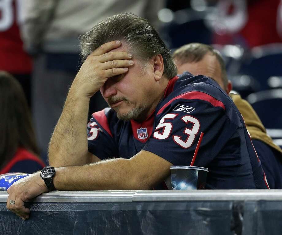 This Texans fan averted his eyes during last year's playoff debacle against Kansas City, which featured five turnovers by quarterback Brian Hoyer. QB play that has been mostly mediocre to flat-out abysmal has been a Texans franchise staple. Photo: Karen Warren, Staff / © 2015  Houston Chronicle