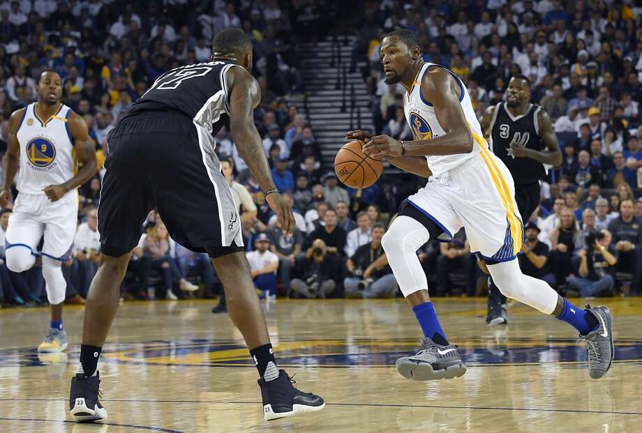 OAKLAND, CA - OCTOBER 25:  Kevin Durant #35 of the Golden State Warriors dribbles the ball up court against the San Antonio Spurs during the second quarter in an NBA basketball game at ORACLE Arena on October 25, 2016 Oakland, California. NOTE TO USER: User expressly acknowledges and agrees that, by downloading and or using this photograph, User is consenting to the terms and conditions of the Getty Images License Agreement.  (Photo by Thearon W. Henderson/Getty Images) Photo: Getty Images