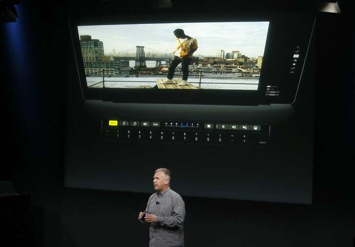 Phil Schiller, senior vice president of worldwide marketing for Apple, describes the new Touch Bar of an updated version of the MacBook Pro laptop at Apple headquarters in Cupertino, Calif. on Thursday, Oct. 27, 2016.