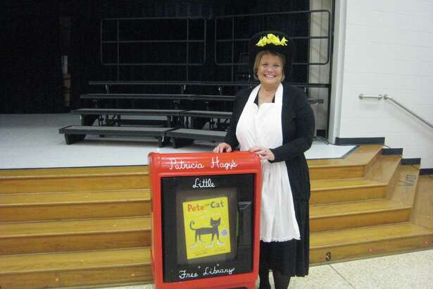 Retired teacher Patricia Hagy poses in front of the Little Free Library named in honor of her that will be placed at Woodland Hills Elementary. The new library box was unveiled during the school's storybook character parade Thursday, Oct. 27.