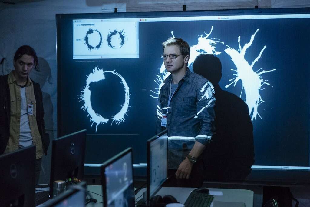 "Jeremy Renner, above, plays a physicist in ""Arrival."" Amy Adams, right, has the lead as a linguist trying to understand aliens. Photo: Paramount Pictures"