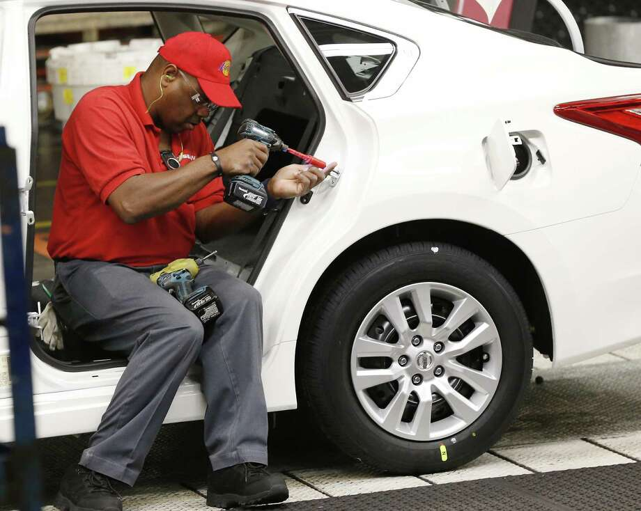 A technician works on a door assembly for a Nissan Altima on the assembly line at the Nissan Canton Vehicle Assembly Plant in Canton, Miss. Orders for durable goods edged down 0.1 percent in September, the Commerce Department said. Orders in the category that serves as a proxy for business investment plunged 1.2 percent in September, the biggest setback since February. Photo: Rogelio V. Solis /Associated Press / Copyright 2016 The Associated Press. All rights reserved. This material may not be published, broadcast, rewritten or redistribu