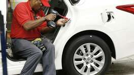 A technician works on a door assembly for a Nissan Altima on the assembly line at the Nissan Canton Vehicle Assembly Plant in Canton, Miss. Orders for durable goods edged down 0.1 percent in September, the Commerce Department said. Orders in the category that serves as a proxy for business investment plunged 1.2 percent in September, the biggest setback since February.