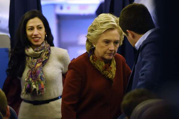 Democratic presidential nominee Hillary Clinton chats with her staff, including aide Huma Abedin (L), onboard her plane in White Plains, New York. The emails about the Clinton Foundation released by WikiLeaks show an intense focus on image, and in turn, a glaring absence of morality. The chatter is often about how to insulate Hillary Clinton from the appearance of a conflict, not about making ethical decisions that avoid such conflicts.