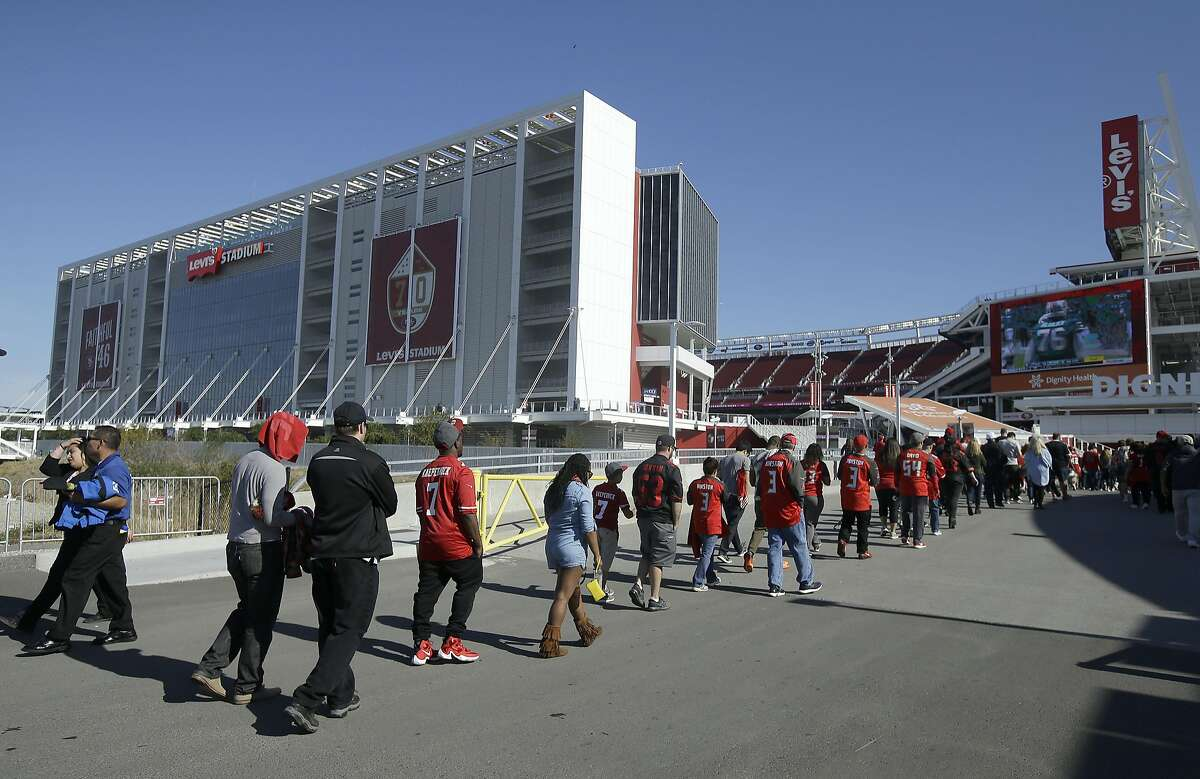 Fans walk into Levi's Stadium before an NFL football game between the San Francisco 49ers and the Tampa Bay Buccaneers in Santa Clara, Calif., Sunday, Oct. 23, 2016. (AP Photo/Jeff Chiu)