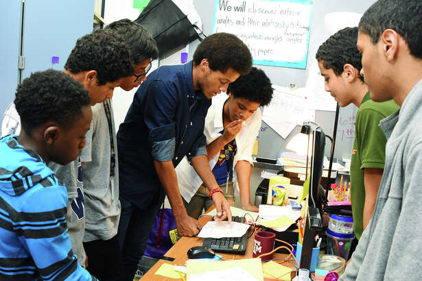 Zavion Williams, left, Fernanda Gaza, Henry Nguyen, Orion Jefferson, Lechandra Gee, Akram Soubaa and Jose' Montes de Oca are working on inventing an apparatus for firefighters to remove condensation from helmets while fighting fires.