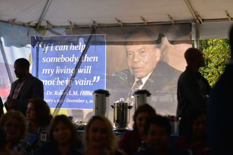 A banner honoring Dr. Robert L.M. Hilliard is the backdrop for the groundbreaking ceremony Thursday for a $5 million University Health System clinic named for him. The East Side facility is scheduled to open next summer Photo: Robin Jerstad /San Antonio Express-News