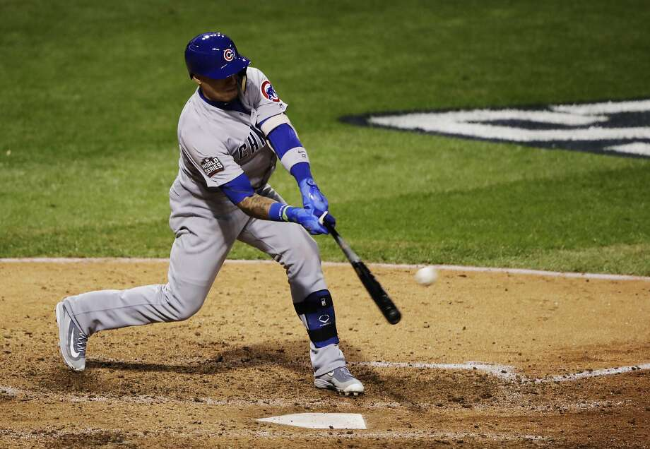 Chicago Cubs' Javier Baez hits a single during the seventh inning of Game 1 of the Major League Baseball World Series against the Cleveland Indians Tuesday, Oct. 25, 2016, in Cleveland. (AP Photo/Gene J. Puskar) Photo: Gene J. Puskar, Associated Press