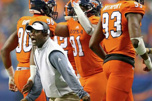 UTSA coach Frank Wilson greets players as they walk off the field after a play against the UTEP Miners on Oct. 22, 2016 at the Alamodome.