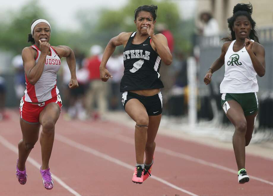 Chloe Cavazos (center) wins the 100 meter race for Steele beating second place finisher Judson's Talajah Murrell (left) and fourth place finisher Reagan's Zskaira Williams as districts 25/26-6A and 27/28-6A hold area track meets at Gustafson Stadium on April 24, 2015. Photo: Tom Reel / San Antonio Express-News