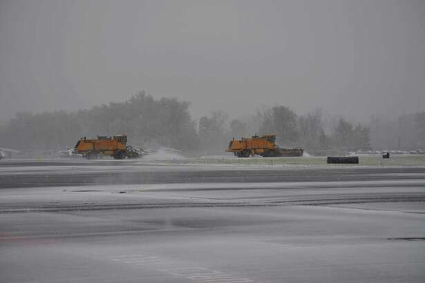 Two airport vehicles removing snow from the main runway at Albany International Airport at 3:30 p.m. October 27, 2016. (Courtesy of Albany International Airport)