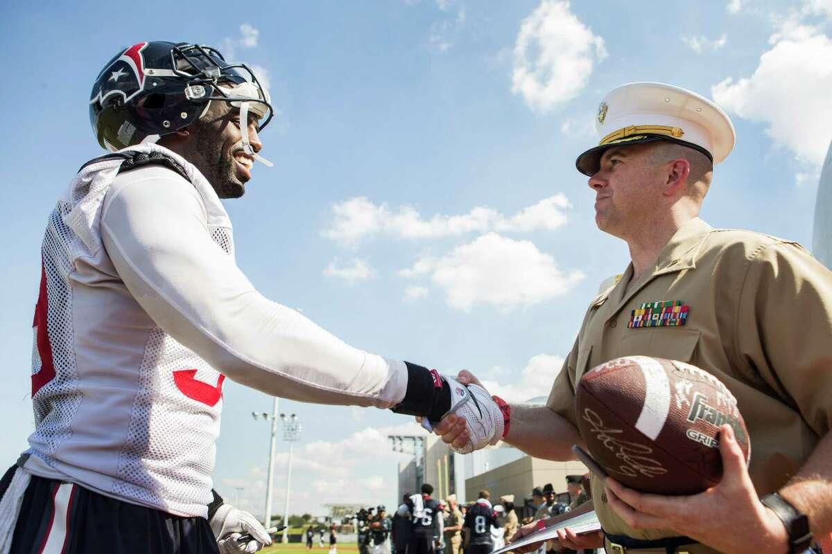 Houston Texans outside linebacker Whitney Mercilus (59) shakes hands with Maj. Nick Perkins during the 10th Annual Salute to Service Miltary Barbecue at NRG Stadium on Thursday, Oct. 27, 2016, in Houston. The Texans hosted more than 200 service members, veterans from the USO, the Wounded Warrior Project and the Lone Star Veterans Assocation with a lunch, provided by HEB and cooked by the Battle Red Tailgate Crew. Following the lunch, they met with Texans players following practice.