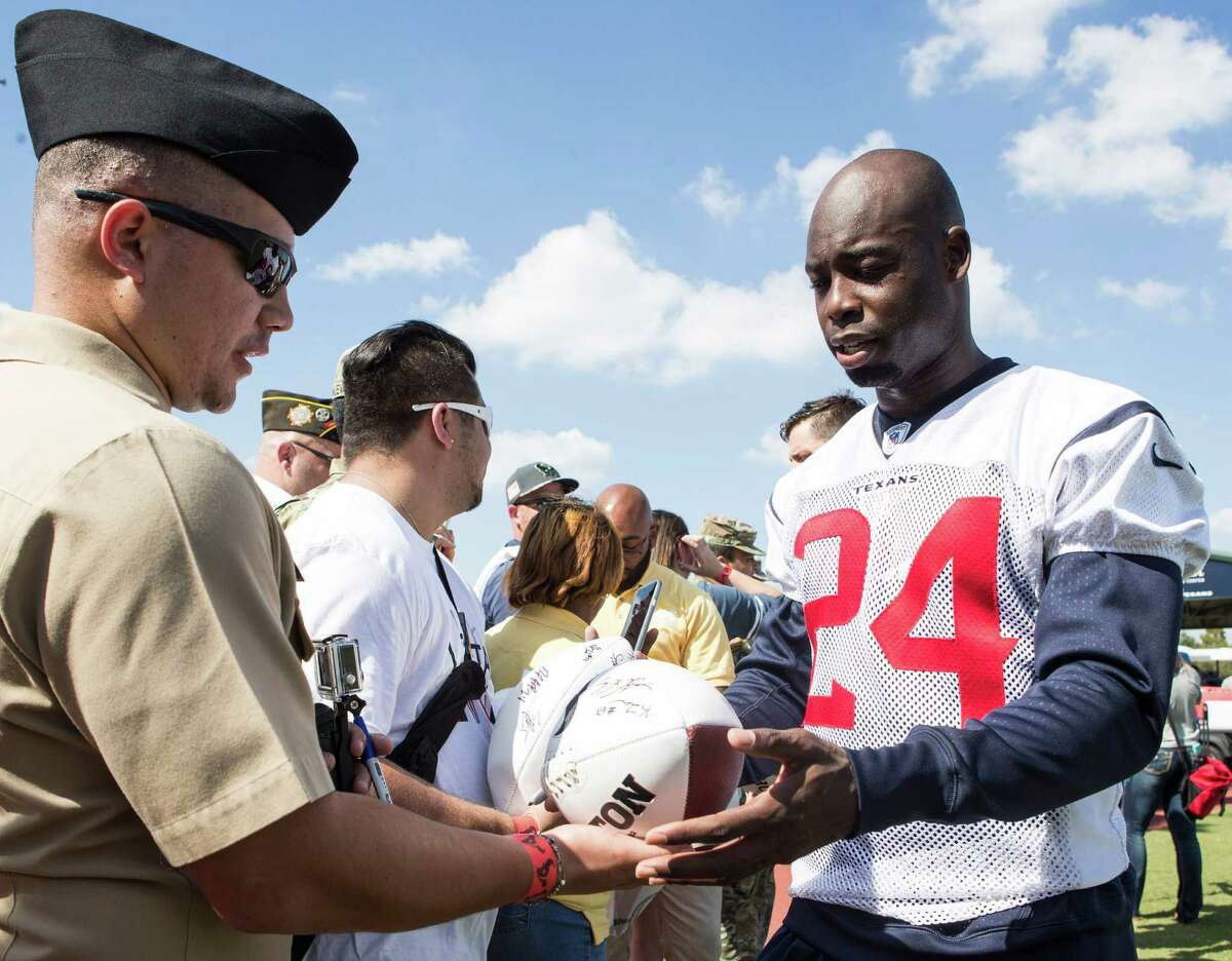 Houston Texans cornerback Johnathan Joseph signs autographs during the 10th Annual Salute to Service Miltary Barbecue at NRG Stadium on Thursday, Oct. 27, 2016, in Houston. The Texans hosted more than 200 service members, veterans from the USO, the Wounded Warrior Project and the Lone Star Veterans Assocation with a lunch, provided by HEB and cooked by the Battle Red Tailgate Crew. Following the lunch, they met with Texans players following practice.