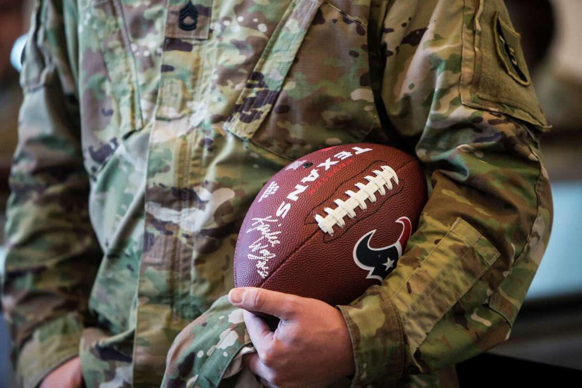 An Army sargeant holds an autographed football during the 10th Annual Salute to Service Miltary Barbecue at NRG Stadium on Thursday, Oct. 27, 2016, in Houston. The Texans hosted more than 200 service members, veterans from the USO, the Wounded Warrior Project and the Lone Star Veterans Assocation with a lunch, provided by HEB and cooked by the Battle Red Tailgate Crew. Following the lunch, they met with Texans players following practice.