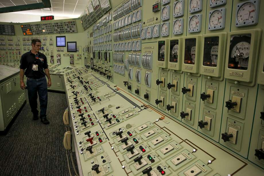 Reactor operator Owen Thomas inside the control room of the steam turbine and generator building at the Diablo Canyon nuclear power plant. PG&E customers will have to pay extra on their bills to help retain and retrain Diablo Canyon employees as the company prepares to shut it down by 2025. Photo: Michael Macor, The Chronicle