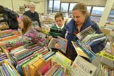 Laurel Bishop shops for books at the Norwalk Public Library Childrens Book Sale with 10yr old son Joeseph on Thursday October 27, 2016. The sale continues and includes all books for every interest, Hardcover, Paperbacks, plus DVD's CD's at the main library this Saturday 9am -5pm, Sun 1-4:30, Mon 9-6pm and Tue. 9-12pm on Belden Ave. in Norwalk Conn.