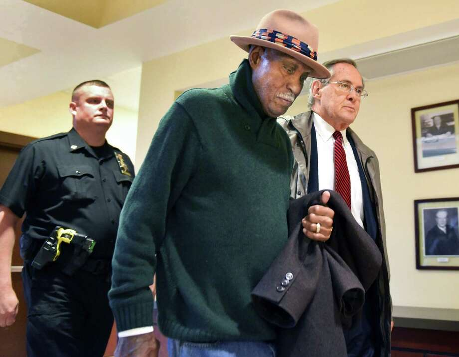 Rev. Edward Smart, center, pastor of First Israel African Methodist Episcopal Church, and his attorney E. Stewart Jones, right, make their way through the Albany Judicial Center where Smart surrendered to authorities Thursday Oct. 27, 2016 in Albany, NY.  (John Carl D'Annibale / Times Union) Photo: John Carl D'Annibale / 20038568A