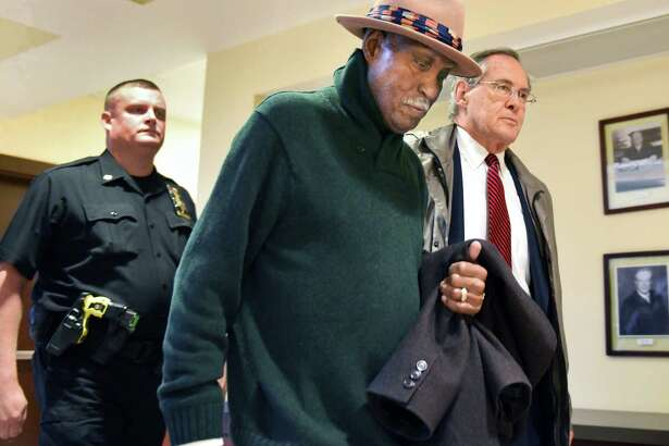 Rev. Edward Smart, center, pastor of First Israel African Methodist Episcopal Church, and his attorney E. Stewart Jones, right, make their way through the Albany Judicial Center where Smart surrendered to authorities Thursday Oct. 27, 2016 in Albany, NY.  (John Carl D'Annibale / Times Union)