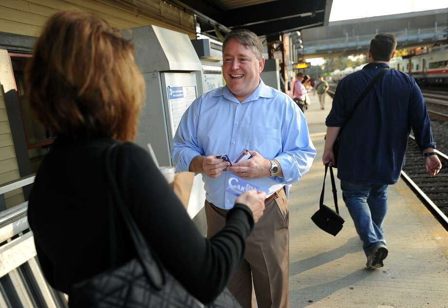 Republican candidate for U.S. Senate Dan Carter, center, introduces himself to voters while campaigning on the platform of the Fairfield train station on Oct. 19. Photo: Brian A. Pounds / Hearst Connecticut Media / Connecticut Post