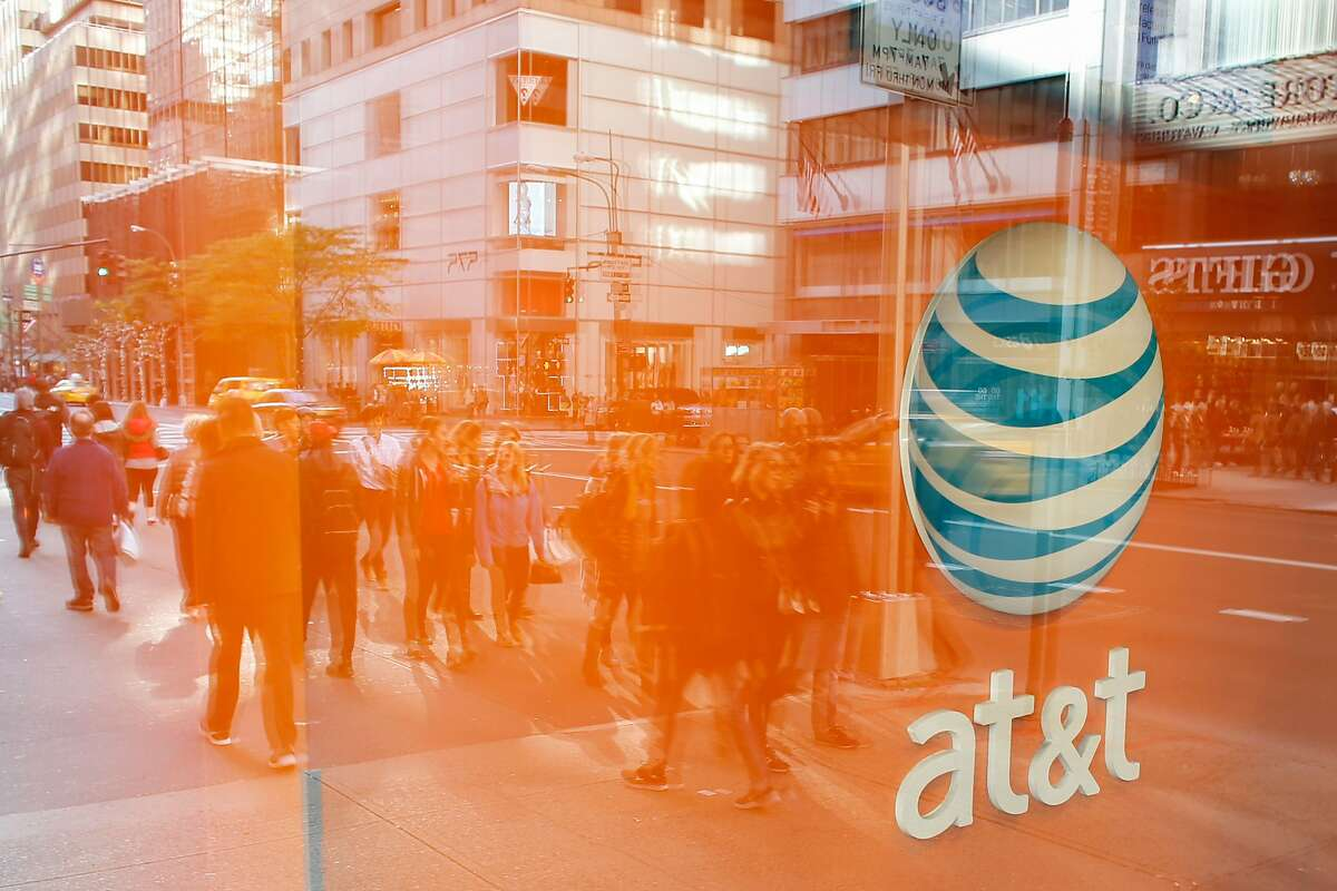 An AT&T store is seen on 5th Avenue in New York on October 23, 2016. AT&T unveiled a mega-deal for Time Warner that would transform the telecom giant into a media-entertainment powerhouse positioned for a sector facing major technology changes. The stock-and-cash deal is valued at $108.7 billion including debt, and gives a value of $84.5 billion to Time Warner -- a major name in the sector that includes the Warner Bros. studios in Hollywood and an array of TV assets such as HBO and CNN. / AFP PHOTO / KENA BETANCURKENA BETANCUR/AFP/Getty Images