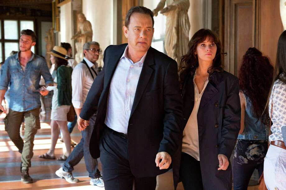 """In this image released by Sony Pictures, Tom Hanks, left, and Felicity Jones appear in a scene from, """"Inferno."""" (Jonathan Prime/Sony Pictures via AP) Photo: Jonathan Prime, HONS / (c) 2015 CTMG, Inc. All rights reserved."""