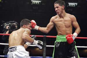 Kendo Castaneda (right) hits Albert Romero during the fourth round of their lightweight fight on Oct. 27, 2012 at the Freeman Coliseum. Castaneda won by unanimous decision.