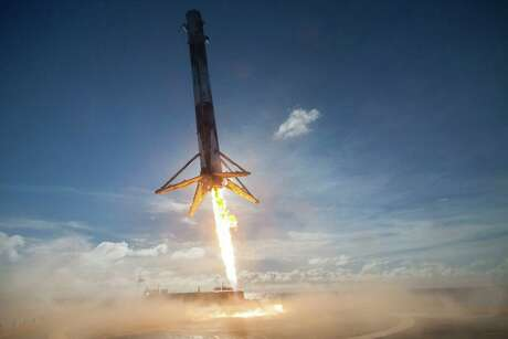 FILE - In this May 27, 2016 photo made available by SpaceX, their Falcon rocket booster lands on a platform in the Atlantic Ocean after launching a satellite into orbit. Its name is a nod to the Millennium Falcon piloted by Han Solo in the Star Wars movie series. It's powered by Merlin engines. (SpaceX via AP)