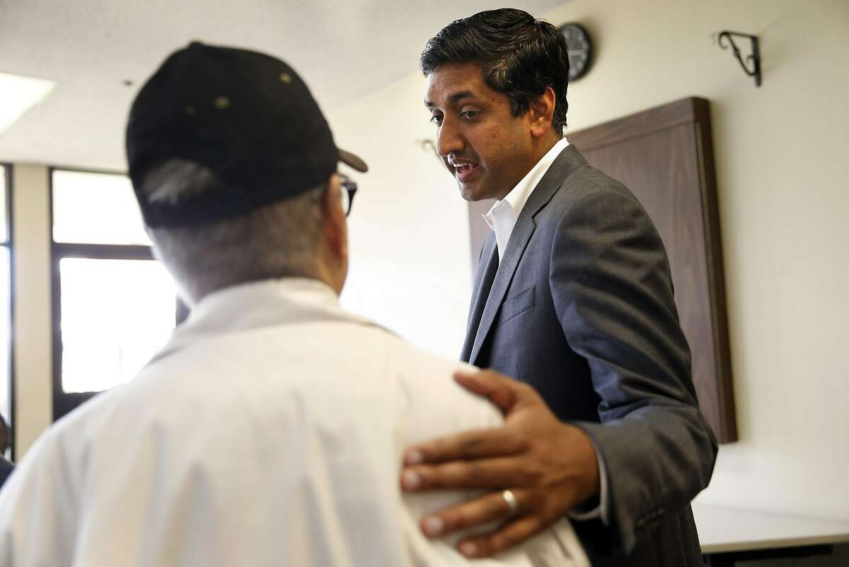 Ro Khanna, Democratic candidate for California's 17th Congressional District, speaks with Milpitas resident. Romeo Castro, before town hall meeting in Milpitas, Calif., on Monday, April 4, 2016.