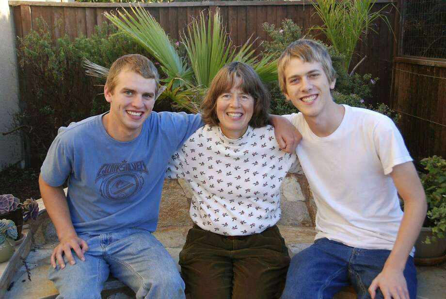 This Dec. 25, 2012, photo taken by Andrew Wiegardt, left, shows him with his brother, Nick Wiegardt as they pose with their mother, Kirsten Englund. Three years ago, Jeffrey Boyce shot and killed Englund at a scenic overlook on the Oregon coast, using one of three weapons purchased by his mother. Boyce's mother has agreed to pay $400,000 to Englund's family and to assist them in their lawsuit against two gun dealers. (Andrew Wiegardt via AP) Photo: Andrew Wiegardt, Associated Press