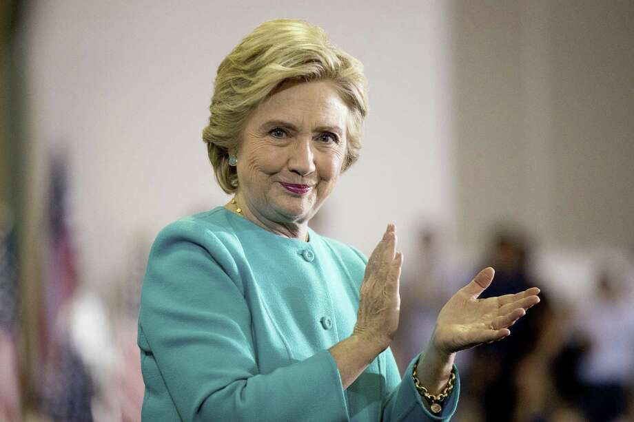 Democratic presidential candidate Hillary Clinton claps as she finishes speaking at a rally at Palm Beach State College in Lake Worth, Fla., Wednesday, Oct. 26, 2016. (AP Photo/Andrew Harnik) Photo: Andrew Harnik, STF / Associated Press / Copyright 2016 The Associated Press. All rights reserved.