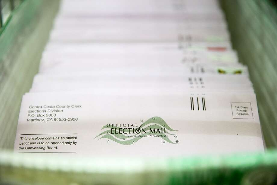 Contra Costa County plans to reimburse the Postal Service for ballots that are delivered without proper postage. Photo: Santiago Mejia, The Chronicle