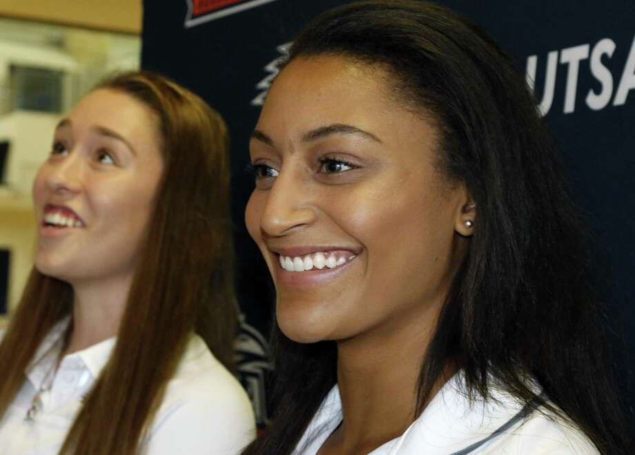 UTSA players Carlie Heineman (left) and Loryn Goodwin talk on media day at the Convocation Center on Oct. 27, 2016. Photo: Ron Cortes /For The Express-News