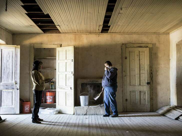 Anna Lunoff, left, Chairman of the Polly Texas Pioneer Association, and Debrah McWilliams, right, begin cleanup at Polly's School house in Bandera County, Texas on Saturday, October 22, 2016. The Polly Texas Pioneer Association is renovating the school house first built in 1892 to display it's history to the public with an open house next Saturday, October 22. The one room school house was in operation from its construction until 1942. The association finished the renovation's of Polly's Chapel in 2014.